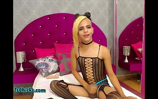 Pretty Tgirl bored in bedroom