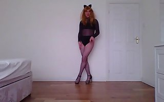 Catsuit and fishnets